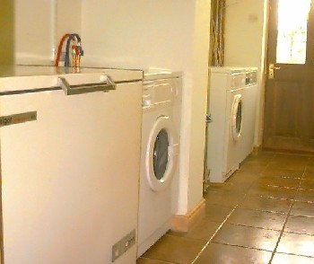 Freezer, washing machine and dryer all in a row